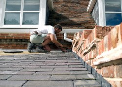 Working on a tiled roof in Sheffield